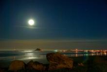 glowing moon over the ocean
